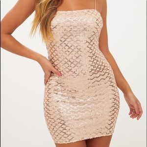 Pink sequence mini dress.